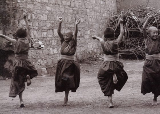 Young monks dancing buddhist joy