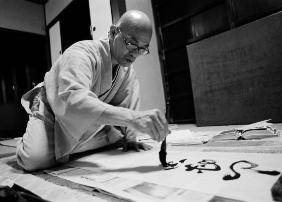 Photo of Shodo Harada Roshi writing calligraphy